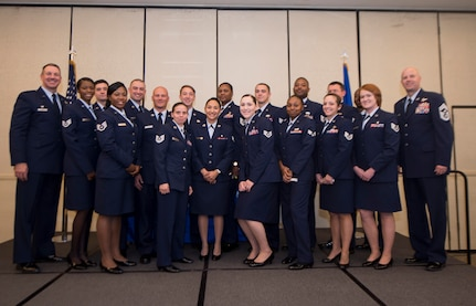 Col. Robert Lyman, 628th Air Base Wing commander (far left), and Chief Master Sgt. Todd Cole (far right), 628th Air Base Wing command chief, pose with 628th ABW Airmen during the fall graduation ceremony for the Community College of the Air Force here Oct. 13, 2016. The CCAF is a federally-chartered, degree-granting institution serving the United States Air Force's enlisted total force.