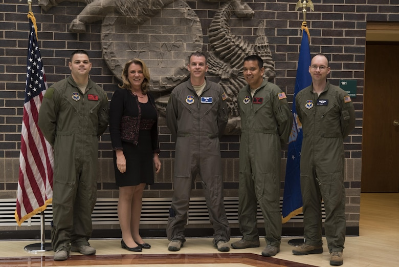 Secretary of the Air Force Deborah Lee James poses with the first four Enlisted Pilot Initial Class students in the U.S. Air Force Initial Flight Training School at Pueblo Memorial Airport in Pueblo, Colorado Oct. 17.  The Air Force announced the initiative to integrate the enlisted force into Remotely Piloted Aircraft flying operations as pilots Dec. 17, 2015 starting with the RQ-4 Global Hawk. Name badges were blurred due to Air Force limits on disclosure of identifying information for RPA operators. (U.S. Air Force photo illustration by Randy Martin)