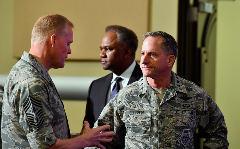 Air Force Chief of Staff Gen. David L. Goldfein speaks with Chief Master Sgt. of the Air Force James A. Cody during the Secretary of the Air Force Spouse and Family Forum at Joint Base Andrews, Md., Oct. 19, 2016. (U.S. Air Force photo/Scott M. Ash)