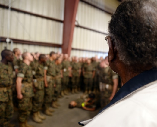 Montford Point Marine Henry L. Jackson observes recruits from Marine Corps Recruit Depot Parris Island, S. C., as they conduct combat care aboard Marine Corps Logistics Base Albany, Oct. 11. More than 6,000 recruits and permanent personnel sought shelter aboard the installation, Oct. 5-11.
