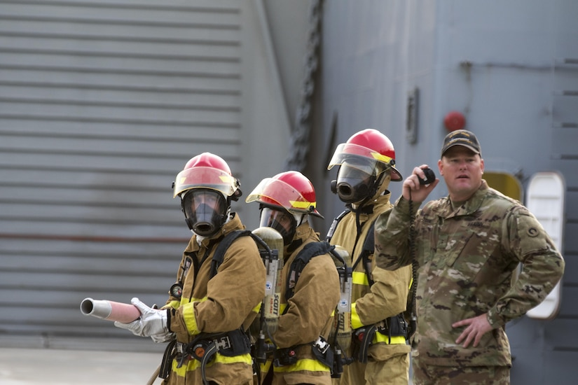 Soldiers from the 411th Transportation Detachment, based at Fort Eustis, Va. and deployed to Kuwait Naval Base, run to react to a notional fire during a drill aboard the MG Charles P. Gross (Logistics Support Vessel-5) in the Arabian Gulf, October 3, 2016. Every Soldier on the ship has to be trained in firefighting response in case of an emergency. (U.S. Army photo by Sgt. Brandon Hubbard, USARCENT Public Affairs)