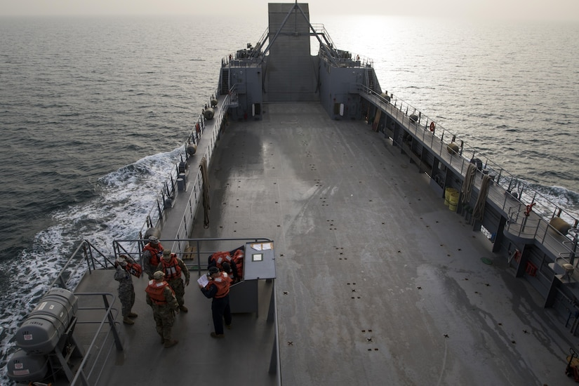 The 411th Transportation Detachment Soldiers aboard the MG Charles P. Gross (Logistics Support Vessel-5) practice their abandon ship drills during a range exercise in the Arabian Gulf, October 3, 2016. The ship, a logistics asset for U.S. Army Central, is responsible for transporting massive tonnage – up to 900 tons – on its deck anywhere in the world. (U.S. Army photo by Sgt. Brandon Hubbard, USARCENT Public Affairs)