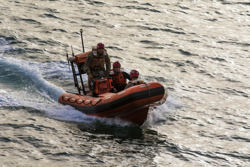 """The 411th Transportation Detachment rescue crew from the the MG Charles P. Gross (Logistics Support Vessel-5) practices searching for a """"man overboard"""" during its drills in the Arabian Gulf, Oct. 3, 2016. The Soldiers routinely prepare for all scenarios while moving up- to 900 tons of cargo for U.S. Army Central from Kuwait Naval Base to other nations in the Middle East.  (U.S. Army photo by Sgt. Brandon Hubbard, USARCENT Public Affairs)"""