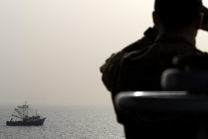 A Soldier from the 411th Transportation Detachment looks out from the bridge of the MG Charles P. Gross (Logistics Support Vessel-5) at a Kuwaiti fishing boat in the Arabian Gulf, October 3, 2016. The ship is responsible for moving cargo throughout the U.S. Army Central area of operations, including Qatar, United Arab Emirates and Bahrain.  (U.S. Army photo by Sgt. Brandon Hubbard, USARCENT Public Affairs)
