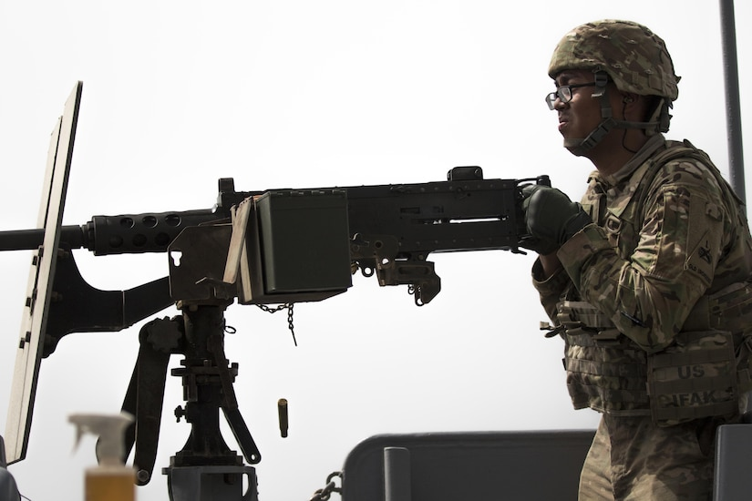 Pfc. Bunnath Chhun, from the 3rd Armored Brigade Combat Team, 1st Infantry Division and a Sheridan, Ind. native, fires the .50 caliber machine gun from the MG Charles P. Gross (Logistics Support Vessel-5) into the Arabian Gulf during a weapons training exercise, October 3, 2016. The ship is part of the large logistics network U.S. Army Central uses to move vehicles and equipment throughout the Central Command theater. (U.S. Army photo by Sgt. Brandon Hubbard, USARCENT Public Affairs)