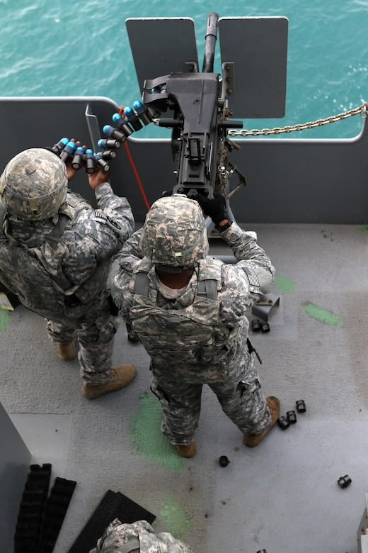 """Soldiers from the 411th Transportation Detachment, U.S. Army Central, fire the Mk19 grenade launcher at a """"Killer Tomato"""" target in the Arabian Gulf, Oct. 3, 2016. The ship is part of the large logistics network U.S. Army Central uses to move vehicles and equipment throughout the Central Command theater. (U.S. Army photo by Sgt. Brandon Hubbard, USARCENT Public Affairs)"""