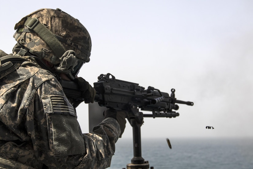 A Soldier from the Fort Eustis, Va.-based 411th Transportation Detachment shoots from the MG Charles P. Gross (Logistics Support Vessel-5)  into the Arabian Gulf off the coast of Kuwait, Oct. 3, 2016. The ship's crew regularly practices firing at large inflatable targets to ensure its mission moving cargo for U.S. Army Central throughout its 20-nation area of operations is not slowed by the threat of hostile waters. (U.S. Army photo by Sgt. Brandon Hubbard, USARCENT Public Affairs)