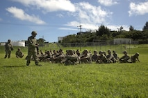 Japan Ground Self-Defense Force Sgt. Imato translates instructions prior to a patrolling exercise during the annual Guard and Protect, an observe and exchange event, Oct. 7 on Marine Corps Air Station Futenma, Okinawa, Japan. The three-day event sharpened U.S. and JGSDF service members' abilities to defend installations through the observation and exchange of tactical procedures and operational concepts. The training included patrolling, rules of engagement and vehicle search and seizure procedures.