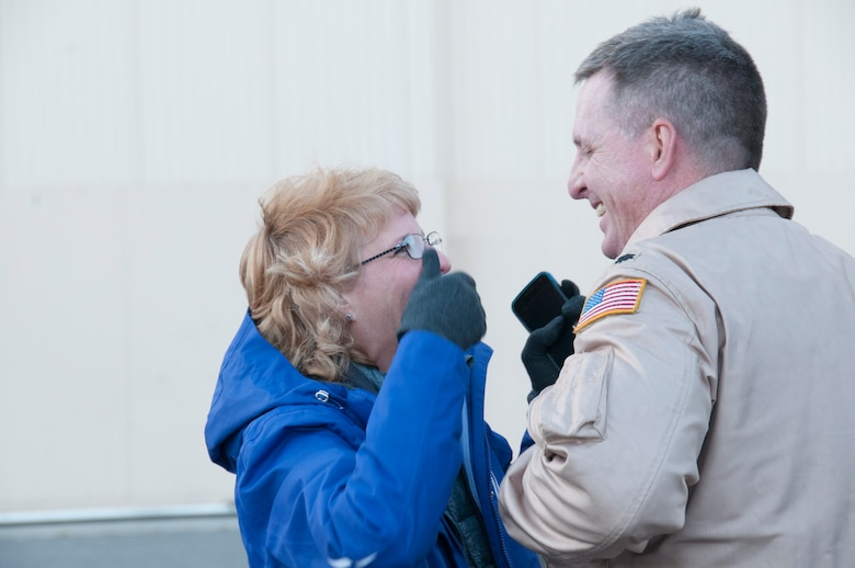 Lt. Col. Buck Smith is welcomed home for the last time by his wife Karyn just outside of the 168th Maintenance Group's hanger at Eielson AFB, Alaska, October 16, 2016, where he and 33 other Airmen from the interior-Alaska Air Guard unit, were greeted by friends and family after they returned home from an extended deployment to Southwest Asia. This was the final deployment for Smith, who will be retiring from the 168th Wing in December 2016. (U.S. Air National Guard photo by Senior Master Sgt. Paul Mann/Released)
