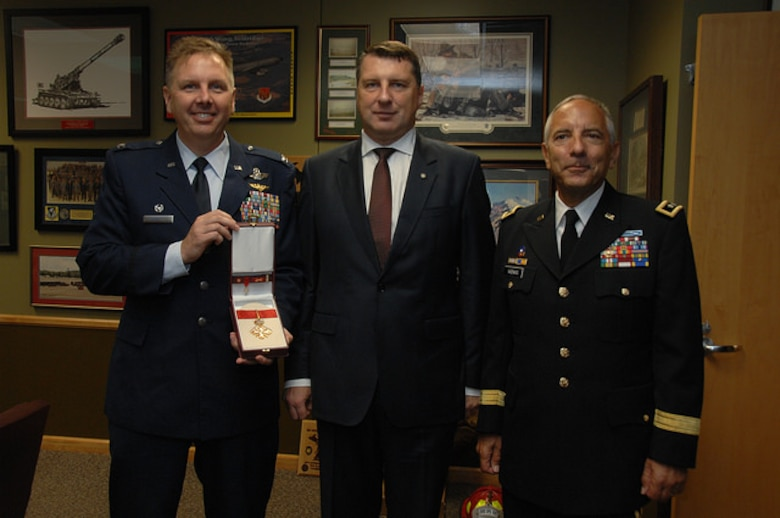 The President of the Republic of Latvia  presented Col. J. Andrew Roberts, commander of the Alpena Combat Readiness Training Center, with the Order of Viesturs medal, Sept. 23, 2016, at the Michigan National Guard headquarters facility in Lansing. The Order of Viesturs is presented only by the President and was given to Roberts to recognize his efforts toward strengthening the country and promoting joint learning between military forces. Roberts served as the bilateral affairs officer to Latvia in 2012 and 2013. Major General Vadnais present on right  (Michigan National Guard photo by Angela Simpson/released).