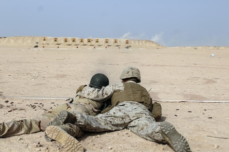 Lance Cpl. Nathaniel Madison, a rifleman with Special Purpose Marine Air-Ground Task Force Crisis Response-Africa, instructs a Mauritanian Fusiler Marin while he fires his weapon during a machine gun range near Rosso, Mauritania, Aug. 30, 2016. Marines worked on small unit tactics, detainee procedures, weapons handling and marksmanship techniques while training with the Mauritanian FUMA to aid in the suppression of illicit trafficking in the region.  (U.S. Marine Corps courtesy photo/released)