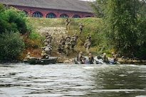 U.S. paratroopers and Italian soldiers rush up a river bank and advance toward their next objective during Livorno Shock 16, an exercise in Piacenza, Italy, Oct. 17, 2016. Army photo by Massimo Bovo