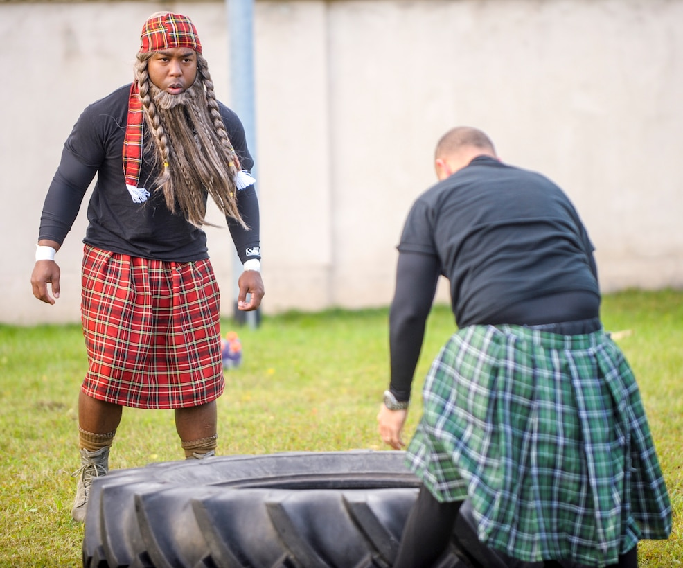 Staff Sgt. Victor Hayes, 450th Intelligence Squadron, waits to compete in a tire flip competition during the 693rd Intelligence, Surveillance and Reconnaissance Group's 5th Annual Highland Games in Wiesbaden, Germany, Oct 14, 2016. Modeled after the Scottish Highland Games, the 693rd ISRG's games tested the strength and endurance of competitors as they took a break from work to build camaraderie and morale. (U.S. Air Force photo by Staff Sgt. Timothy Moore)