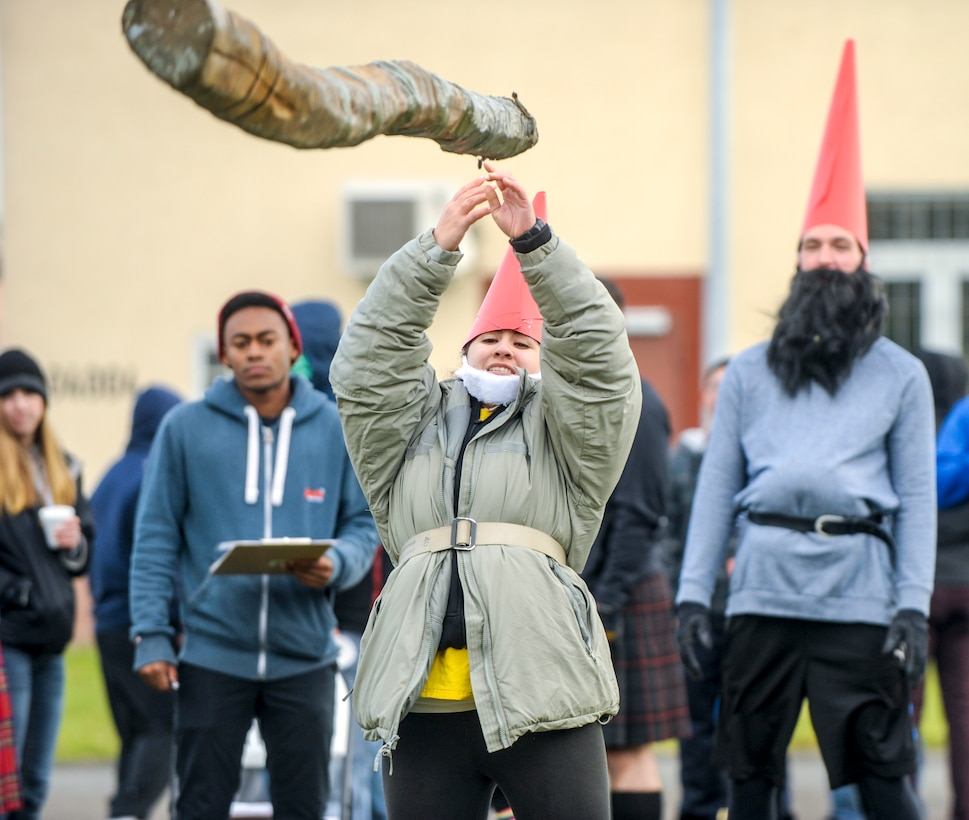 Senior Airman April Rascon, 24th Intelligence Squadron, competes in a caber toss event during the 693rd Intelligence, Surveillance and Reconnaissance Group's 5th Annual Highland Games in Wiesbaden, Germany, Oct. 14, 2016. Airmen from the 693rd ISRG competed against each other during the event, which was designed to allow them the opportunity to connect with each other outside of the work environment. (U.S. Air Force photo by Staff Sgt. Timothy Moore)