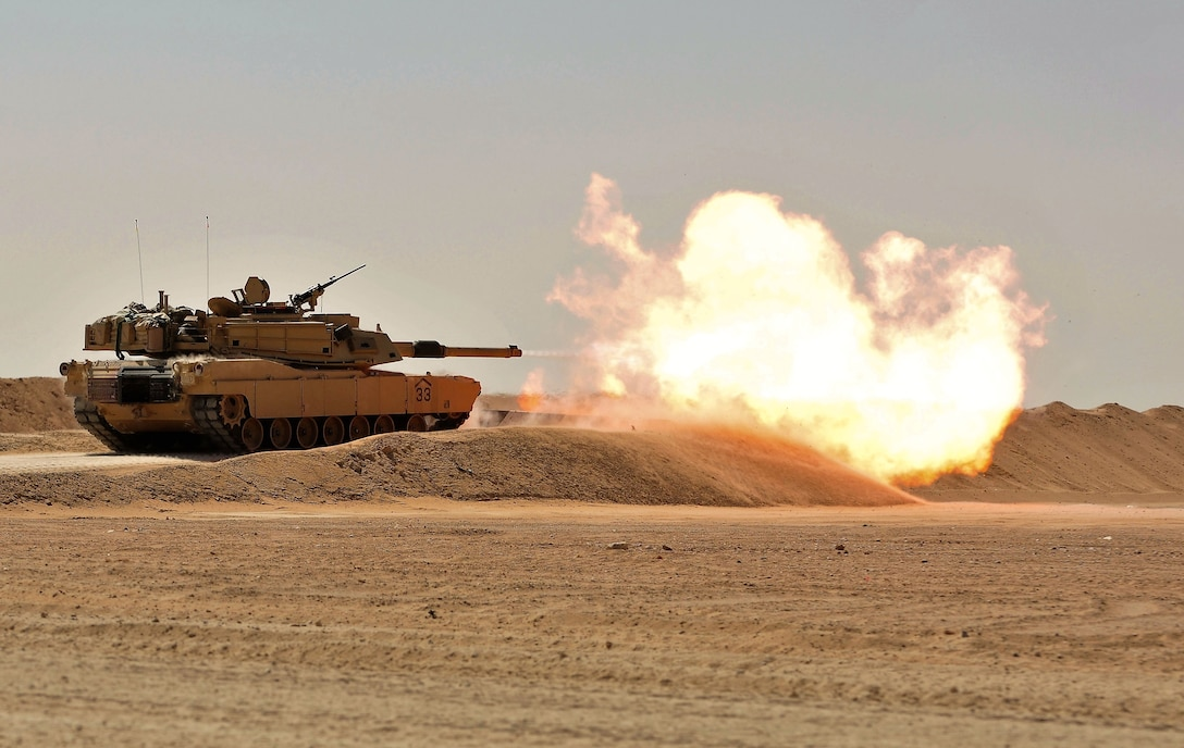 CAMP BUEHRING, Kuwait — Soldiers from the 3rd Armored Brigade Combat Team, 1st Armored Division, conduct a M1A2 Abrams Main Battle Tank live-fire range at Camp Buehring, Kuwait Oct. 18, 2016. Command Sgt. Maj. Eric C. Dostie, U.S. Army Central senior noncommissioned officer, was present to witness and participate in the event. Dostie also met with Soldiers, toured the units' facilities, and spoke to senior NCOs about new Army initiatives during a luncheon. Dostie's visit is part of his current battlefield circulation to meet and receive feedback from Soldiers throughout the ARCENT area of responsibility. (U.S. Army photo by Sgt. Aaron Ellerman)