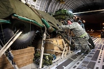 Air Force Staff Sgt. Andrew Ammerman, foreground, loads a pallet of equipment onto a C-17 Globemaster III aircraft during exercise Red Flag Alaska 17-1 at Joint Base Elmendorf-Richardson, Alaska, Oct. 11, 2016. Ammerman is an aerial port specialist assigned to the 621st Contingency Response Support Squadron. Air Force photo by Master Sgt. Joseph Swafford