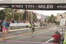Spc. Susan Tanui, a dental assistant with Dental Activity, crosses the finish line of the Army Ten-Miler Oct. 9 in Washington, D.C., earning second place in the female military overall competition with a time of 59 minutes, 43 seconds. Tanui placed 199th among all competitors.