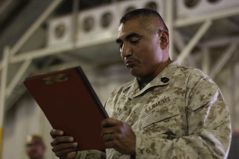 """First Sergeant Emilio Hernandez reads the U.S. Marine Corps Commandant's message to the sailors at Camp Wilson, Calif., Oct. 13, 2016. General Robert B. Neller, the Commandant of the Marine Corps wrote to the U.S. Navy, """"Happy 241st Anniversary to the world's greatest Navy. Know that all Marines join you in celebrating your proud legacy and are honored to serve with you since 13 Oct. 1775."""" 1st Sergeant Emilio Hernandez is the first sergeant for Headquarters Company, 4th Marine Regiment, 3rd Marine Division. (U.S. Marine Corps photo by Lance Cpl. Juan A. Soto-Delgado)"""