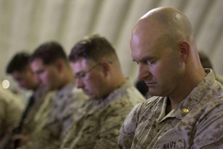 Sailors pray before the cutting of the cake ceremony at Camp Wilson Calif. Oct. 13, 2016. Sailors and Marines gather together for the celebration of the 241st U.S. Navy birthday. The sailors are with 1st Battalion, 2nd Marine Regiment, 2nd Marine Division. (U.S. Marine Corps photo by Lance Cpl. Juan A. Soto-Delgado)