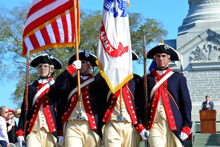 The Old Guard from Commander and Chief Guard, marches after the national anthem during a wreath-laying ceremony at the French Monument in Yorktown Va., Oct. 19, 2016. On Oct. 19, 1781, the American and French army won the battle of Yorktown against the British army. (U.S. Air Force photo by Airman 1st Class Tristan Biese)