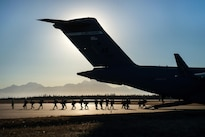Airmen direct soldiers as they exit a C-17 Globemaster III aircraft during exercise Red Flag Alaska 17-1 at Allen Army Airfield, Alaska, Oct. 13, 2016. The soldiers are assigned to the 25th Infantry Division's 4th Brigade Combat Team (Airborne). Air Force photo by Master Sgt. Joseph Swafford