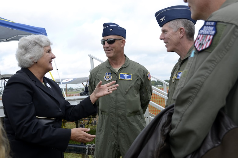 "Susan d'Olive, daughter of 1st Lt. Charles d'Olive, the last officially recognized U.S. ""Ace"" of World War I, shares some memories with Brig. Gen. Vito Addabbo, Mobilization Assistant to the Commander, Air Force Global Strike Command, Barksdale Air Force Base, Louisiana, and Lt. Col James Morriss, vice commander of the 307th Bomb Wing, Barksdale AFB, at the Dawn Patrol Rendezvous event held at the National Museum of the United States Air Force in Ohio, Oct. 1, 2016.  All three were part of a painting unveiling ceremony honoring d'Olive and 100 years of Reserve Airpower. (U.S. Air Force photo/Staff Sgt. Joel McCullough)"