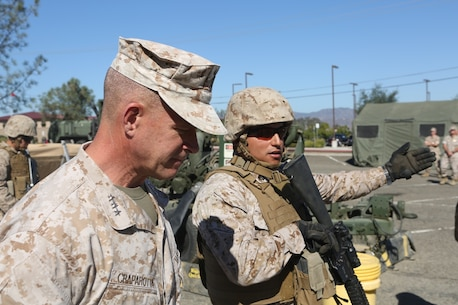 U.S. Marine Corps Sgt. Oscar Tapia demonstrates the capabilities of an amphibious assault fueling station to Lt. Gen. Lewis Craparotta, the commanding general of the I Marine Expeditionary Force, aboard Camp Pendleton, Calif., Oct. 19, 2016. Craparotta visited the 1st MLG to see the most up-to-date capabilities the logistics command has to offer I MEF. Tapia is a combat engineer with 7th Engineer Support Battalion, 1st Marine Logistics Group. (U.S. Marine Corps photo by Lance Cpl. Joseph Sorci)