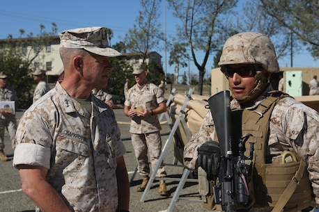 U.S. Marine Corps Sgt. Oscar Tapia explains the capabilities of an amphibious assault fueling station to Lt. Gen. Lewis A. Craparotta, the commanding general of the I Marine Expeditionary Force, aboard Camp Pendleton, Calif., Oct. 19, 2016. Craparotta visited the 1st MLG to see the most up-to-date capabilities the logistics command has to offer I MEF. Tapia is a combat engineer with 7th Engineer Support Battalion, 1st Marine Logistics Group. (U.S. Marine Corps photo by Lance Cpl. Joseph Sorci)