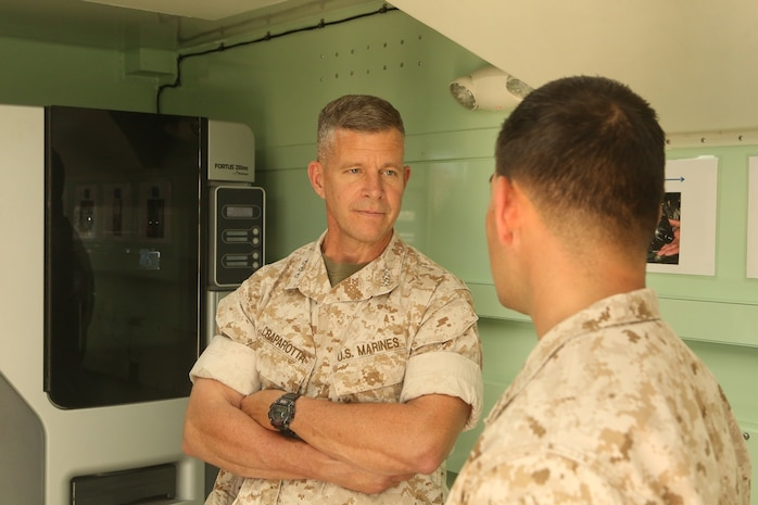 U.S. Marine Corps Lt. Gen.  Lewis Craparotta, the commanding general of the I Marine Expeditionary Force, listens to Cpl. Samuel Stonestreet explain the capabilities of 3-D printing aboard Camp Pendleton, Calif., Oct. 19, 2016. Craparotta visited the 1st MLG to see the most up-to-date capabilities the logistics command has to offer I MEF.  Stonestreet is a ground radio repairman with 1st Transportation Support Battalion, Combat Logistics Regiment 1, 1st Marine Logistics Group. (U.S. Marine Corps photo by Lance Cpl. Joseph Sorci)