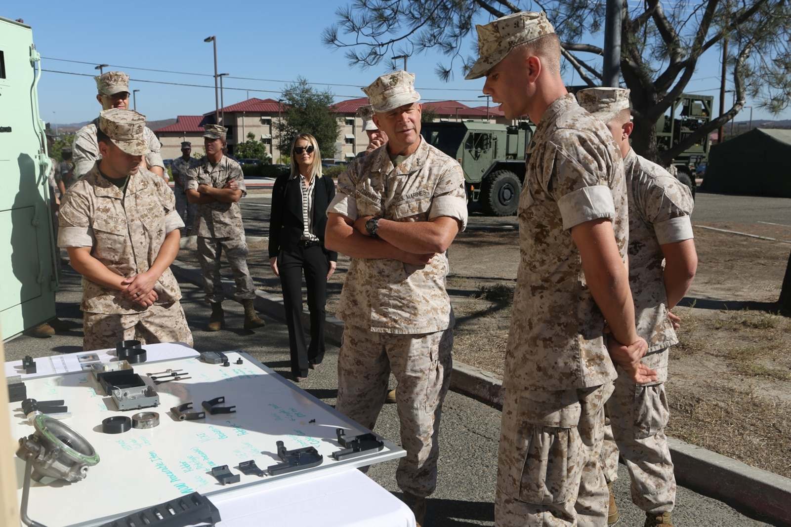 U.S. Marine Corps Lt. Gen. Lewis Craparotta, the commanding general of the I Marine Expeditionary Force, listens while Cpl. Samuel Stonestreet informs him on the capabilities of 3-D printing to Lt. Gen. Lewis Craparotta, the commanding general of the I Marine Expeditionary Force, aboard Camp Pendleton, Calif., Oct. 19, 2016. Craparotta visited the 1st MLG to see the most up-to-date capabilities the logistics command has to offer I MEF.  Stonestreet is a ground radio repairman with 1st Transportation Support Battalion, Combat Logistics Regiment 1, 1st Marine Logistics Group. (U.S. Marine Corps photo by Lance Cpl. Joseph Sorci)