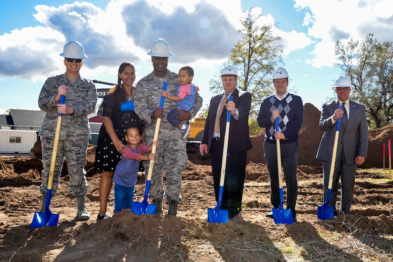 Members of the Air Force and the base's privatized housing contractor, Boyer Hill Military Housing, prepare to break ground on 10 new homes Oct. 19 at Hill Air Force Base, Utah. The homes will be made available to Hill AFB's junior enlisted military families. Left to right: Col. Jennifer Hammerstedt, 75th Air Base Wing commander; housing residents Staff Sgt. James Charnell Coates, his wife Charnell and their two children; Rulon Gardner, BHMH owner; Brent Pace, BHMH president; and Harry Briesmaster, 75th Civil Engineer Group director. (U.S. Air Force by R. Nial Bradshaw)