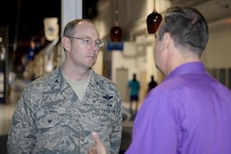U.S. Air Force Col. David Berg (left), 55th Wing vice commander, talks with Kenneth Komyathy, family advocacy director, about the display set up to support Domestic Violence Awareness month in the Offutt Field House at Offutt Air Force Base, Neb., Oct. 18, 2016. According to the Department of Defense, domestic violence is an offense under the United States Code, the Uniform Code of Military Justice or state law that involves the use, attempted use, threat, use of force, violence against a person who is a current or former spouse, a person who shares a child with the abuser, a current or former intimate partner with whom the abuser shares a common domicile. (U.S. Air Force photo by Zachary Hada)