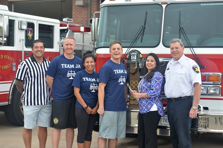 Team JA stands for a photo after winning the Annual Fire Muster Challenge at Goodfellow Air Force Base, Texas, Oct. 14, 2016. Team JA won with a time of 7 minutes and 47 seconds. (U.S. Air Force photo by Airman 1st Class Randall Moose/Released)