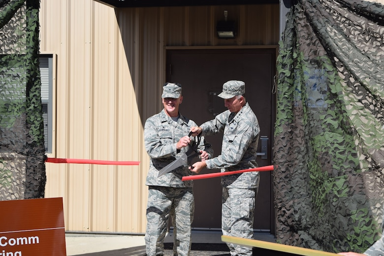 Colonel Jeremy Boenisch, 5th Combat Communications Group commander, along with Lieutenant General William J. Bender, Chief Information Officer, Office of the Secretary of the Air Force, cut the ribbon during the opening ceremony for the new Combat Communications Engineering Integration Center (EIC) located at Robins AFB, Ga. 19 Oct.   Effective 25 Sep 2016, the EIC was established as a central engineering and validation element for the modernization of combat communications units throughout the total force.