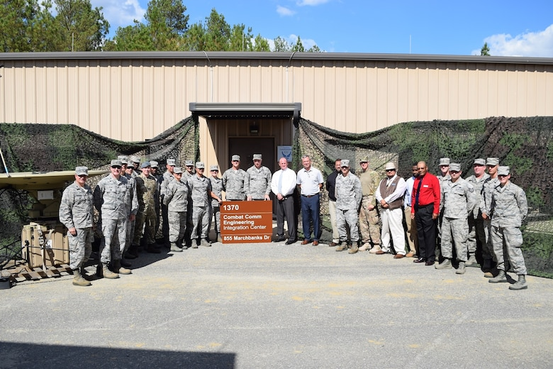 Members of the 5th Combat Communications Group, 226th Air National Gaurd, the Air Force Reserve Command A6, and several others pose in front of the new Combat Communications Engineering Integration Center at Robins AFB 19 Oct.