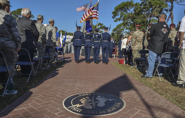 The Hurlburt Field Honor Guard posts the colors during the Special Tactics Memorial dedication ceremony at Hurlburt Field, Fla., Oct. 20, 2016. The memorial was conceptualized by Steve Haggett, a 30-year retired chief master sergeant, who served 14 years in Air Force Special Operations Command as a first sergeant and maintenance crew chief. Haggett volunteered to lead the project, from concept to design to final creation. (U.S. Air Force photo by Senior Airman Ryan Conroy)