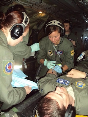 Capt. Slugocki inserts an IV into a simulated patient during a training mission at Kadena Air Base, Japan.