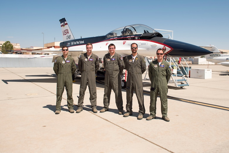 U.S. Air Force Test Pilot School students with Class 16A -- Capt. Daniel Edelstein, Capt. Clark McGehee, Capt Craig Porter, Italian Air Force Capt. Raffaele Odesco, and French Air Force Maj. Nicolas Langevin – tested the L1 Adaptive Contol System recently using the F-16 Variable In-flight Stability Test Aircraft, or VISTA. (Courtesy photo)