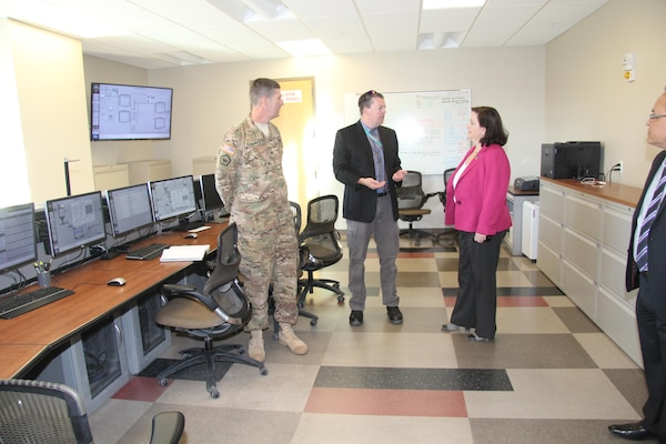 Christopher Woodruff, water resources manager, Fort Irwin Department of Public works (center), briefs Assistant Secretary of the Army for Installations, Energy, and Environment Katherine Hammack (right), and South Pacific Division Commander Col. Pete Helmlinger (left) on the Irwin Water Works water treatment process during a tour of the IWW facility at Fort Irwin, California Oct. 13.