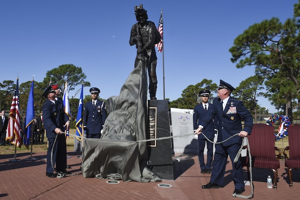 Air Force Chief of Staff David L. Goldfein and Lt. Gen. Brad Webb, the commander of Air Force Special Operations Command, unveil the Special Tactics Memorial during a dedication ceremony at Hurlburt Field, Fla., Oct. 20, 2016. The seven-foot bronze statue of a Special Tactics Airman in operational gear is a memorial to past, present and future Special Tactics operators.  (U.S. Air Force photo by Senior Airman Jeffrey Parkinson)