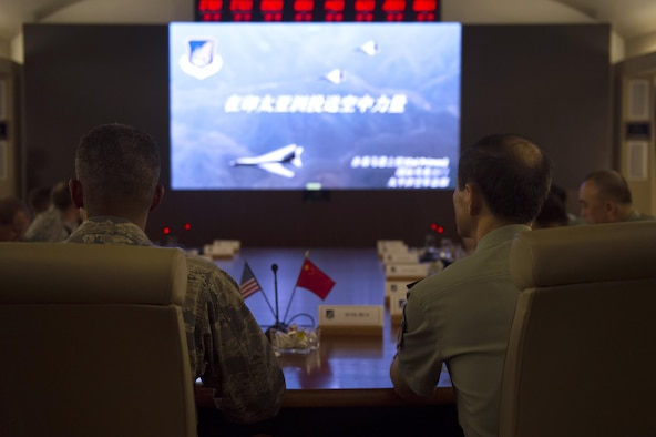 People's Liberation Army Senior Col. Hua Bo and U.S. Air Force Col. Art Primas, Pacific Air Forces International Affairs division chief, receive a briefing during a mid-level officer exchange at Joint Base Pearl Harbor-Hickam, Hawaii, Oct. 18, 2016. The PLA delegation visited PACAF as part of an annual exchange tour that included a stop at U.S. Pacific Command. (U.S. Air Force photo by Staff Sgt. Alexander Martinez)