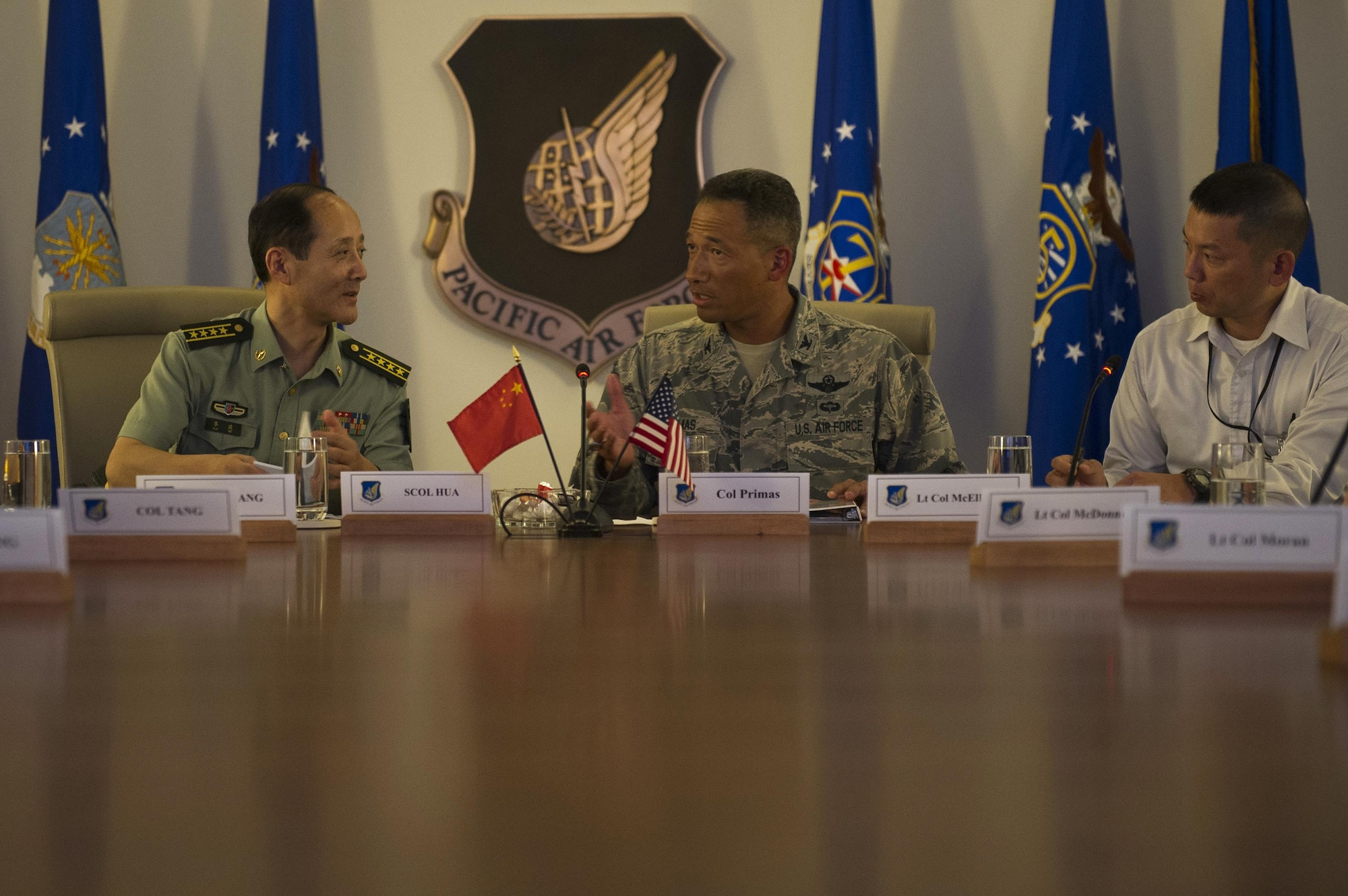 People's Liberation Army Senior Col. Hua Bo and U.S. Air Force Col. Art Primas, Pacific Air Forces International Affairs division chief, speak during a mid-level officer exchange at Joint Base Pearl Harbor-Hickam, Hawaii, Oct. 18, 2016. The PLA delegation visited PACAF as part of an annual exchange tour that included a stop at U.S. Pacific Command. (U.S. Air Force photo by Staff Sgt. Alexander Martinez)