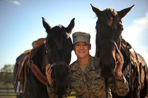 Airman 1st Class Lauren Nolan, 22nd Logistics Readiness Squadron materials management journeyman, poses for a photo with her horses, Tiz and Shoobie, Oct. 13, 2016, in Wichita, Kan. When Nolan moved to McConnell Air Force Base, Kan. her first duty station she had her horses shipped to the area and now boards them off-base in the local community. (U.S. Air Force photo/ Airman 1st Class Jenna K. Caldwell)