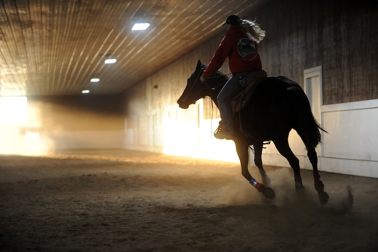 Airman 1st Class Lauren Nolan, 22nd Logistics Readiness Squadron materials management journeyman, practices her barrel racing patterns with her horse, Shoobie, Oct. 13, 2016, in Wichita, Kan. Shoobie is a 6 year old off-the-track thoroughbred. Nolan works with her to train for barrel racing competitions.  (U.S. Air Force photo/ Airman 1st Class Jenna K. Caldwell)