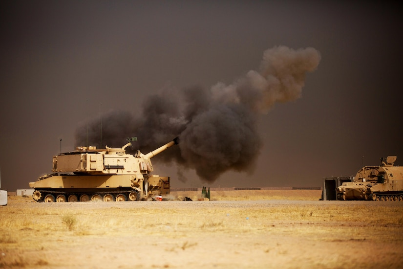 A U.S. Army M109A6 Paladin conducts a fire mission at Qayyarah West, Iraq, in support of the Iraqi security forces' push toward Mosul, Oct. 17, 2016.  The support provided by the Paladin teams denies the Islamic State of Iraq and the Levant safe havens while providing the ISF with vital artillery capabilities during their advance. The United States stands with a Coalition of more than 60 international partners to assist and support the Iraqi security forces to degrade and defeat ISIL.  (U.S. Army photo by Spc. Christopher Brecht)