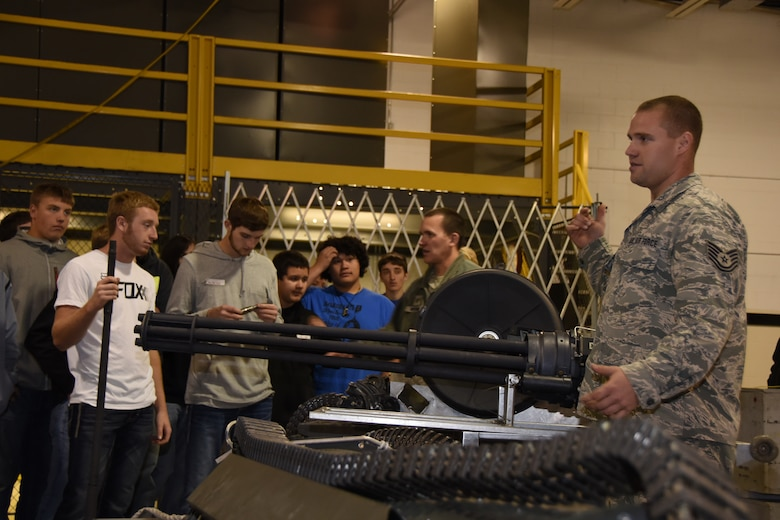 Tech. Sgt. Mike Larson and Tech. Sgt. Bret Werning, 114th Aircraft Maintenance weapons specialists, discuss what being a weapon specialists means to them to high school students during Career Day at Joe Foss Field, S.D. Oct. 19 ,2016. Career day showcases different vocations which the Airmen of the 114 FW perform on a daily basis. (U.S. Air National Guard photo by Staff Sgt. Duane Duimstra/Released)