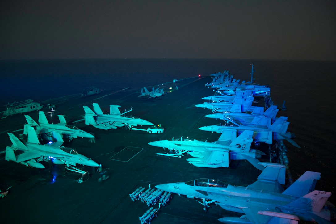161019-N-QN175-071  ARABIAN GULF (Oct. 19, 2016) Sailors prepare for flight operations on the flight deck of the aircraft carrier USS Dwight D. Eisenhower (CVN 69) (Ike). Ike and its Carrier Strike Group are deployed in support of Operation Inherent Resolve, maritime security operations and theater security cooperation efforts in the U.S. 5th Fleet area of operations. (U.S. Navy photo by Seaman Dartez C. Williams)
