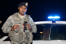 U.S. Air Force Airman 1st Class Robin John, 100th Security Forces Squadron response force member, poses for a photograph while on the nightshift Oct. 12, 2016, on RAF Mildenhall, England. John was born in India and adopted at age 16 by a family from Texas. (U.S. Air Force photo by Gina Randall)