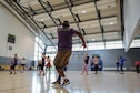 Master Sgt. Willie Williams, 86th Medical Support Squadron laboratory NCO in charge, instructs a Zumba class held to raise awareness for domestic violence at Ramstein Air Base, Germany, Oct. 14, 2016. Williams and two other instructors led a group of approximately 35 people through a series of Zumba dance exercises. (U.S. Air Force photo by Airman 1st Class Savannah L. Waters)