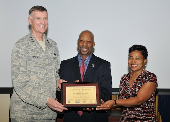 161019-D-ZS915-018: DLA Director Air Force Lt. Gen. Andy Busch and acting EEO Deputy Director Janice Samuel present Micah McCreary a certificate of appreciation for his help in highlighting National Disability Employment Awareness Month.
